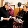 Don Knight | The Herald Bulletin<br /> Steve Williamson receives the elements of communion from First United Methodist Church Senior Pastor Corinne Boruff during a Good Friday Service at Church Upon the Rock on Friday. This was the 18th year for the community service.