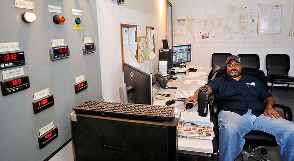 "John P. Cleary | The Herald Bulletin<br /> Anthony Wilkerson, certified operator, monitors the equipment in the control room of the Wheeler Ave. plant. ""We can check the chloride and fluoride going into the water,"" he said. ""We can also check our wells and the water tanks from here."""