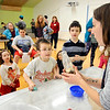 John P. Cleary | The Herald Bulletin<br /> Paige Yoder, Children's Services Librarian at Anderson Public Library, shows  kids an egg inside the bottle after it was sucked into it by creating an vacuum inside the bottle. This was part of the Eggs-periments for Kids event at the library Monday.