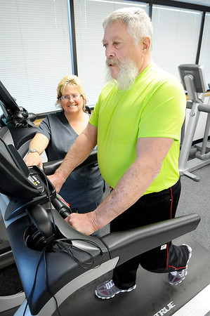 "Don Knight | The Herald Bulletin<br /> Technician Candie Hileman works with Rondal Wright as he exercises at St. Vincent Anderson's Cardiac Rehab on Friday. Wright was one of the founders of the group ""Chatters of the Heart."""
