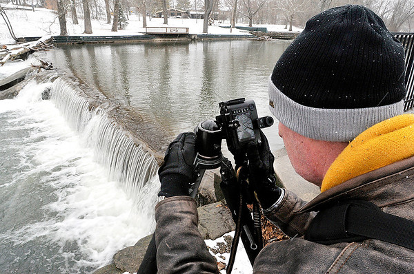 John P. Cleary | The Herald Bulletin<br /> Dr. Stephen Wright photographs the different scenes in Falls Park in Pendleton after a fresh snowfall blanketed the area Saturday afternoon.