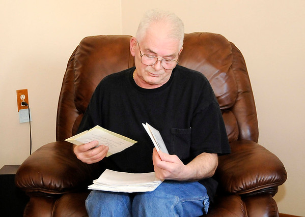 Don Knight | The Herald Bulletin<br /> Mike Murphy looks through the documents he has accumulated over the years trying to get the county to fix the drain in his neighborhood.