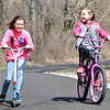 John P. Cleary | The Herald Bulletin<br /> Best friends Taylee Trahan, 9, and Sydney Webb, 9, enjoy the bright sun and above normal temperatures Monday, on their first day of spring break, riding around the trails of Shadyside Park. Both girls are third-graders at Tenth Street Elementary School. With spring starting officially at 11:15 a.m. Tuesday morning, the forecast calls for colder temperatures with a change of rain changing to snow.