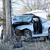 Don Knight | The Herald Bulletin<br /> Both the driver and passenger in this Chevy Cavalier were airlifted to St. Vincent Hospital 86th Street  after the car veered of County Road 200 West and hit a tree according to the Sheriff's Department.