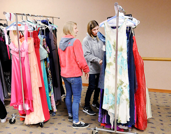 Don Knight | The Herald Bulletin<br /> Taylor Nepsa and Andrea Smith look for a prom dress for Taylor during the Anderson Public Library's Prom Dress Giveaway on Saturday.