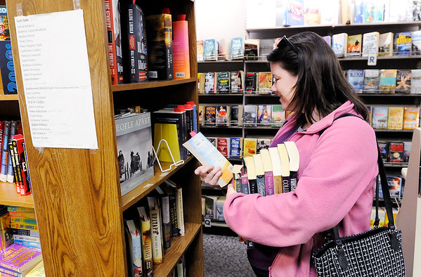 Don Knight | The Herald Bulletin<br /> Angie Brown browses the book selection at The Book Nook on Saturday. The store raises funds for the Madison County Literacy Coalition is looking.