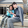 John P. Cleary | The Herald Bulletin<br /> Jadelynn Smith, 12, and Bryant Cox, 14, sit out front of the Anderson Public Library Monday afternoon. The teens, along with two others, were attacked downtown recently after being asked to leave the library.