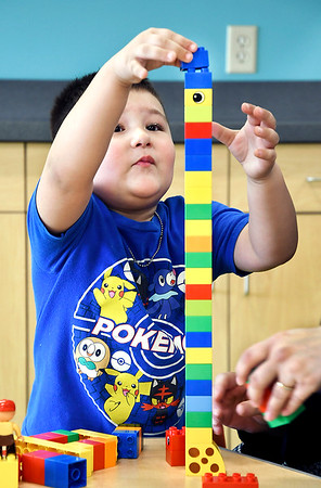 John P. Cleary | The Herald Bulletin<br /> Dominick Reyes, 4, carefully stacks Legos pieces into a tall tower with the help of his mother Rachel Reyes Monday March 25, 2019 in the Children's Department of the Anderson Public Library in Anderson, Ind. Reyes says they come to the library every Monday to enjoy the facility and their activities.
