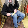 Don Knight | The Herald Bulletin<br /> Terry Dotson whittles the bark from his walking stick during a workshop at Mounds State Park on Saturday.
