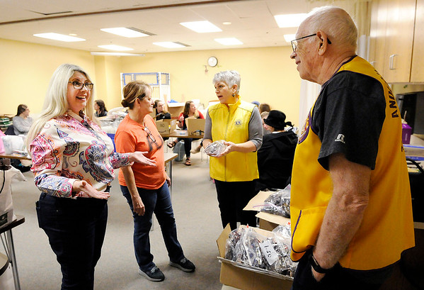 Don Knight | The Herald Bulletin<br /> From left, nursing professors Sarah Cox and Dr. Pat Kline accept 400 pairs of reading glasses from Lions Club president Katherine Holtzleiter and Arlyn Engbrecht on Tuesday. The glasses will be distributed by 17 Anderson University students on a mission trip to Uganda.