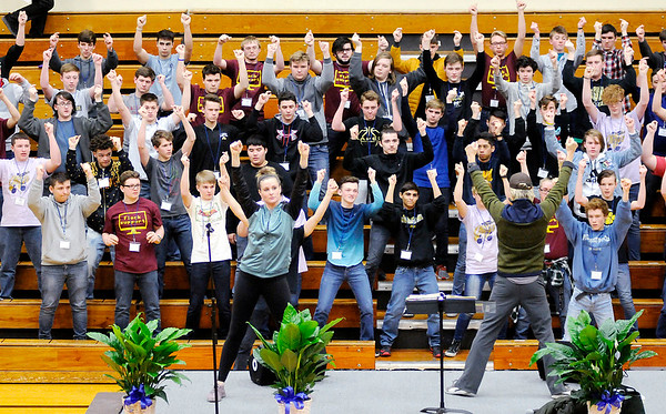 Don Knight   The Herald Bulletin<br /> Students learn choreography from Kenny Shepard for the 75th Annual Madison County Choral Festival on Tuesday. Students from Alexandria, Elwood, Frankton, Lapel, Madison-Grant and Pendleton took part in the event.