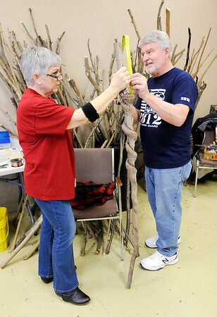 Don Knight   The Herald Bulletin<br /> Earl Evans advises Katherine Holtzleiter on the length to maker her walking stick during a workshop at Mounds State Park on Saturday. Holtzleiter found the stick and has held on to it with the intention of turning it into a walking stick one day.