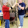 Don Knight | The Herald Bulletin<br /> Earl Evans advises Katherine Holtzleiter on the length to maker her walking stick during a workshop at Mounds State Park on Saturday. Holtzleiter found the stick and has held on to it with the intention of turning it into a walking stick one day.