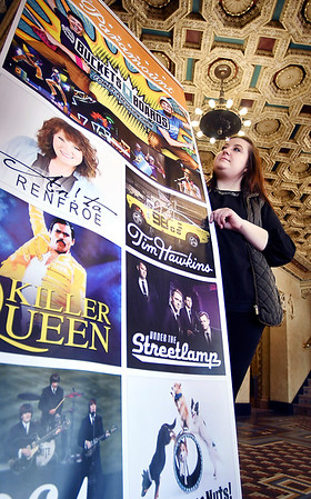 """John P. Cleary   The Herald Bulletin<br /> Taylor Bowlin, volunteer coordinator for the Paramount Theatre, looks at the giant poster promoting upcoming shows at the Paramount Theatre. Bowlin says """"we are always in need of people. Whether it's to take tickets, work in the box office, concessions, ushers--or just someone to help answer people's questions, we are always in need of people."""""""