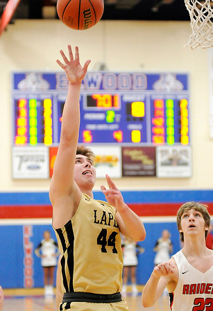 Don Knight | The Herald Bulletin<br /> Lapel's Luke Richardson scores from the low post on an assist from Bryce Carpenter as the Bulldogs faced Wapahani in the sectional semi-final at Elwood on Friday.
