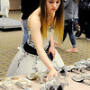Don Knight | The Herald Bulletin<br /> After choosing a dress Ivory Wasson looks for a pair of shoes during Anderson Public Library's Project Fairy Godmother prom dress giveaway  on Saturday.