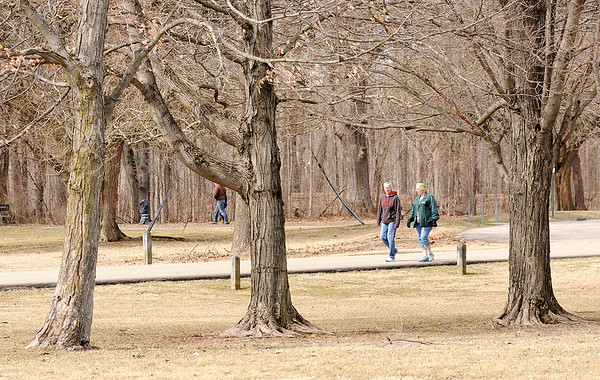 Don Knight | The Herald Bulletin<br /> The warm weather brought out the walkers to Mounds State Park on Tuesday. The National Weather Service is forecasting highs in the 60s for Wednesday and Thursday but they include rain strong winds.