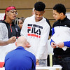 Don Knight | The Herald Bulletin<br /> From left, Anderson High School freshman Jeremy Nunn, Brian Raymore and TaeDeion Collins talk about driver education with The Driving Center owner Robbie Starkey during Anderson's College and Career Fair on Thursday.
