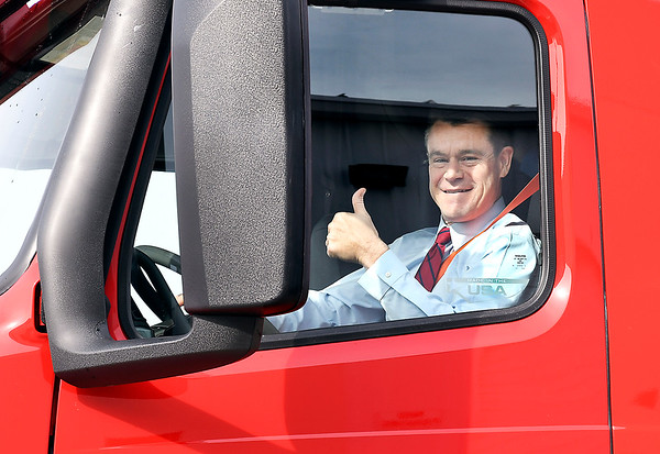 John P. Cleary   The Herald Bulletin<br /> U.S. Senator Todd Young, R-IN, gives a thumbs-up after taking a Carter Express semi-truck for a drive around the company's property Friday. The Indiana Senator was in Anderson with representatives of the Indiana trucking industry regarding his bill, the DRIVE-Safe Act, at Carter Express.