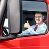 John P. Cleary | The Herald Bulletin<br /> U.S. Senator Todd Young, R-IN, gives a thumbs-up after taking a Carter Express semi-truck for a drive around the company's property Friday. The Indiana Senator was in Anderson with representatives of the Indiana trucking industry regarding his bill, the DRIVE-Safe Act, at Carter Express.