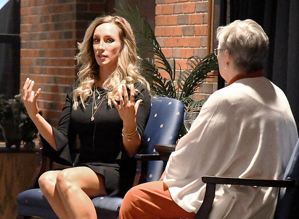 John P. Cleary   The Herald Bulletin<br /> former Indianapolis Colts cheerleader Jill Eicher speaks with Anderson University history professor Jaye Rogers at the annual International Women's Day dinner held at Reardon Auditorium Monday evening.