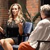 John P. Cleary | The Herald Bulletin<br /> former Indianapolis Colts cheerleader Jill Eicher speaks with Anderson University history professor Jaye Rogers at the annual International Women's Day dinner held at Reardon Auditorium Monday evening.