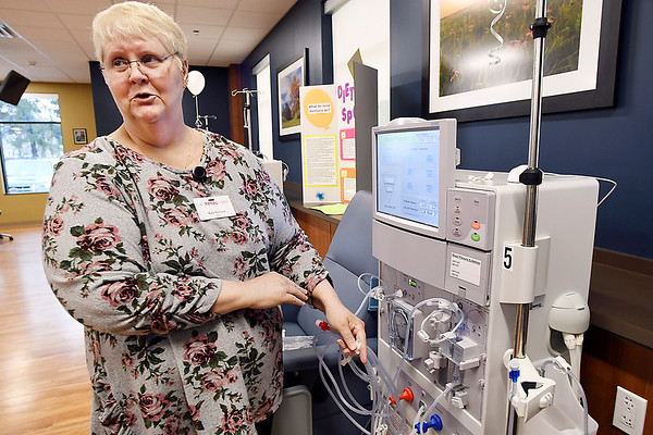 John P. Cleary | The Herald Bulletin<br /> U.S. Renal Care Anderson dialysis clinic RN, Ann Wilcoxon, explains how one of the dialysis machines is setup for a patients treatment during the open house Thursday for their new facility at 2220 East 59th Street.