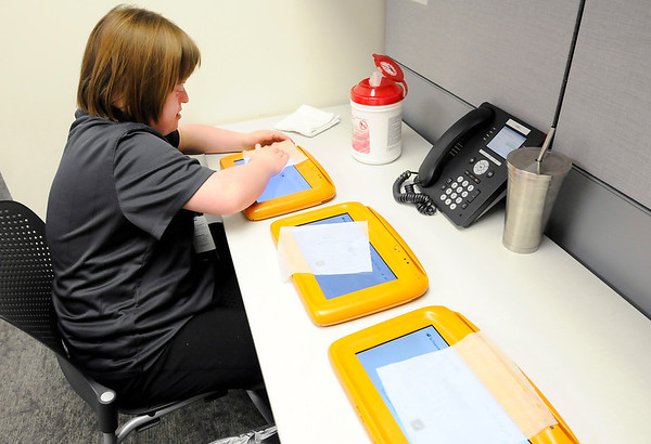 Don Knight   The Herald Bulletin<br /> Emily Johnson cleans the tablets patients use when they check in at Central Indiana Otolaryngology on Wednesday.