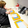 Don Knight | The Herald Bulletin<br /> Emily Johnson cleans the tablets patients use when they check in at Central Indiana Otolaryngology on Wednesday.
