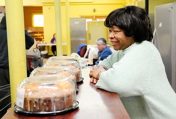 Don Knight   The Herald Bulletin<br /> Vickie Ash volunteers at the food bank at Operation Love on Wednesday.