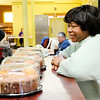 Don Knight | The Herald Bulletin<br /> Vickie Ash volunteers at the food bank at Operation Love on Wednesday.