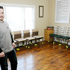Don Knight | The Herald Bulletin<br /> Case manager Karl Lazar stands in the meeting room at Grace House's new  men's house in Anderson.