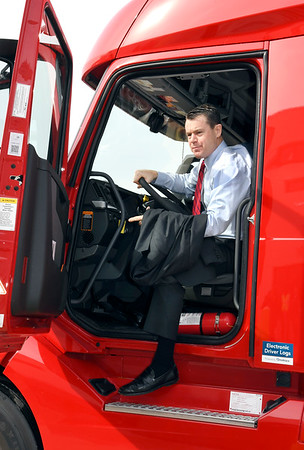 John P. Cleary   The Herald Bulletin<br /> U.S. Senator Todd Young, R-IN, climbs out of the cab of a Carter Express semi-truck after taking it for a drive around the company's property Friday. The Indiana Senator was in Anderson with representatives of the Indiana trucking industry regarding his bill, the DRIVE-Safe Act, at Carter Express.