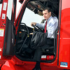 John P. Cleary | The Herald Bulletin<br /> U.S. Senator Todd Young, R-IN, climbs out of the cab of a Carter Express semi-truck after taking it for a drive around the company's property Friday. The Indiana Senator was in Anderson with representatives of the Indiana trucking industry regarding his bill, the DRIVE-Safe Act, at Carter Express.