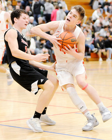 Don Knight | The Herald Bulletin<br /> Frankton's Ethan Bates draws a blocking foul from Sheridan's Steve Smith during the sectional semi-final at Elwood on Friday.