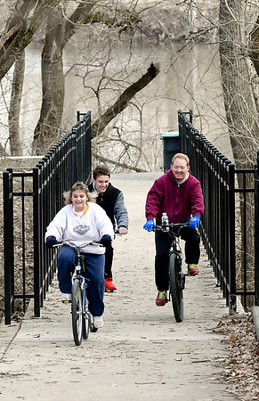 John P. Cleary   The Herald Bulletin<br /> The Pierce family, Mike, Melinda and son Xavier, 15, center, enjoy the warmer temperatures Tuesday afternoon riding their bikes around the trails at Shadyside Park.