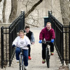 John P. Cleary | The Herald Bulletin<br /> The Pierce family, Mike, Melinda and son Xavier, 15, center, enjoy the warmer temperatures Tuesday afternoon riding their bikes around the trails at Shadyside Park.