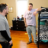 Don Knight | The Herald Bulletin<br /> From left, case manager Karl Lazar talks to Braxton Streeval at Grace House's new home for men. Grace House has four homes open with two more being renovated.