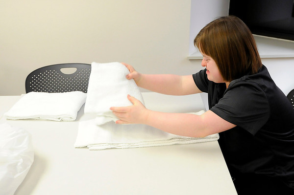 Don Knight | The Herald Bulletin<br /> Emily Johnson folds towels as she volunteers at Central Indiana Otolaryngology on Wednesday.