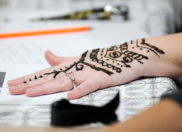 Don Knight   The Herald Bulletin<br /> Marisa Kelley-Rigney decorated her hand with a temporary Henna tattoo during a class at the A Town Center on Saturday.