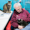 Don Knight | The Herald Bulletin<br /> Steve Duncin sits in the cat room Super Saturday open house at the Animal Protection League on Saturday.
