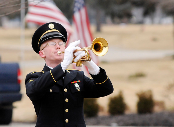 Don Knight | The Herald Bulletin<br /> PFC Abraham Faulkner plays taps during the funeral service for WWII veteran 1st Lt. Shirley W. Warfield on Thursday at Anderson Memorial Park Cemetery on Thursday.