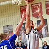 Richard Sitler | For The Herald Bulletin<br /> Shenandoah's Peyton Starks attempts a layup over Eastern Hancock defender Brady Stephens in the semi-finals of 2A boys sectionals at Knightstown on Friday.