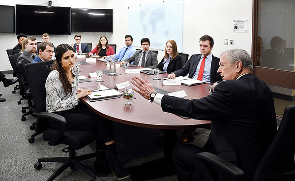 John P. Cleary | The Herald Bulletin <br /> Former U.S. Attorney General John Ashcroft speaks to about a dozen Anderson University national security political science students in the Situation Room Thursday during his visit to campus.