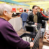 Don Knight | The Herald Bulletin<br /> From left, volunteer Mary Gutierrez helps James Williams as he goes through the food bank at Operation Love on Wednesday.