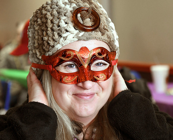 John P. Cleary | The Herald Bulletin<br /> Nancy Zimmerman gets in to the party mode with her Mardi Gras mask while attending the Fat Tuesday Community Lunch-Cajun Style held at the Christian Center.