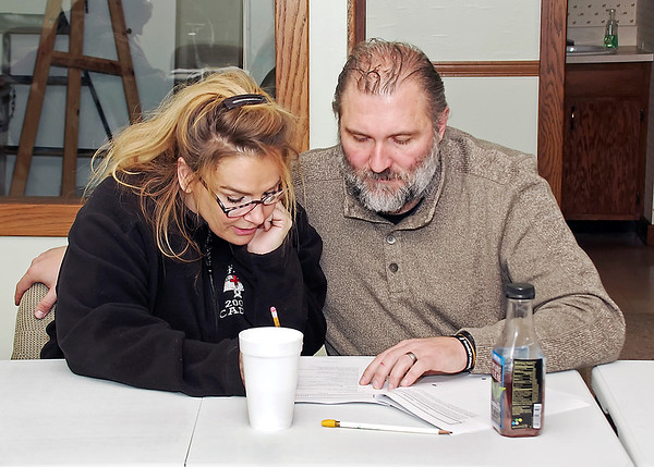 Mark Maynard | for The Herald Bulletin<br /> Nikki and Ronnie Gullion collaborate in completing a work-sheet as part of the Strengthening Families Program.
