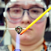 John P. Cleary | The Herald Bulletin<br /> AHS junior Lexi Stafford works her rod to help shape her heart shaped glass bead she is making in Katherine Kester's art class.