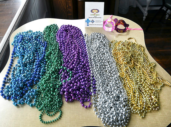 John P. Cleary | The Herald Bulletin<br /> Party beads were a plenty for those attending the Mardi Gras themed Fat Tuesday Community Lunch-Cajun Style held at the Christian Center.