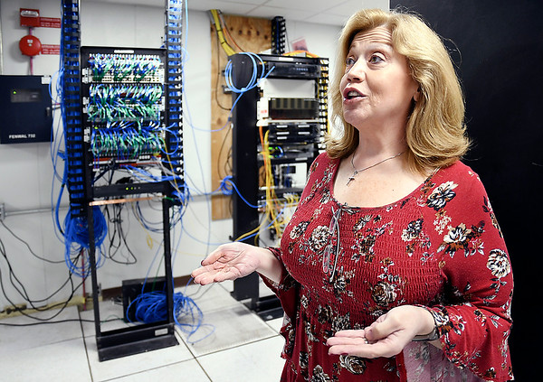 John P. Cleary | The Herald Bulletin<br /> Lisa Cannon, director of the Information Technology Department for Madison County, says all the county computers and public safety agency mobile units have to be replaced because of Microsoft's switch to the Windows 10 operating platform.